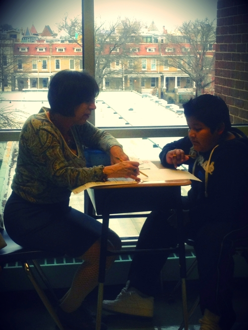 Laurie Kauffman delivers an assessment test to a FLOC student.
