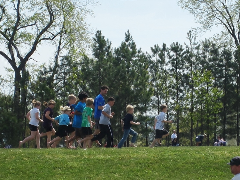 "Children participating in the barefoot running clinic at last year's ""Just Move It"" Health Expo"