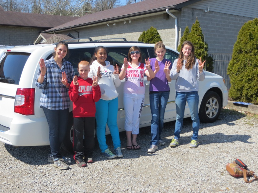 Imoné (third from the left) and her friends pose in front of the van on their alternative spring break.