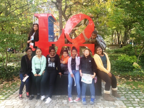A group of Middle School Scholars with their student guide at the famous LOVE sculpture