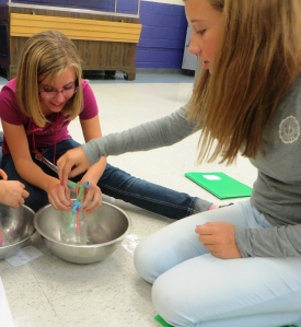 Students craft a heart pump with straws, water, and a jar
