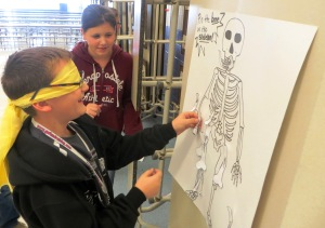"Students play ""Pin the Bone""."