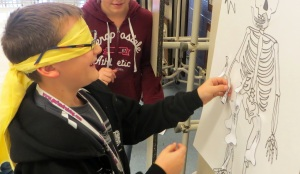"Jacob plays ""Pin the Bone on the Body"" while learning about human anatomy."