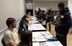 Jim Coleman addressing questions from a student during the College Fair.