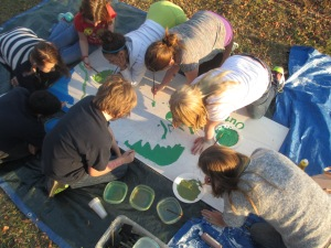 LIA students paint the OEC in preparation for the Holiday Parade.