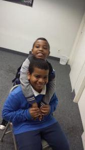 Juel hugs his brother Julian.